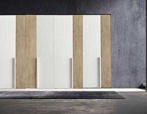 armadio dual style colombini  con 8 ante colori frassino bianco e essenza olmo miele