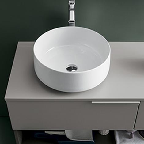Mobile bagno con lavabo in ceramica da appoggio by rab for Mobile lavabo appoggio