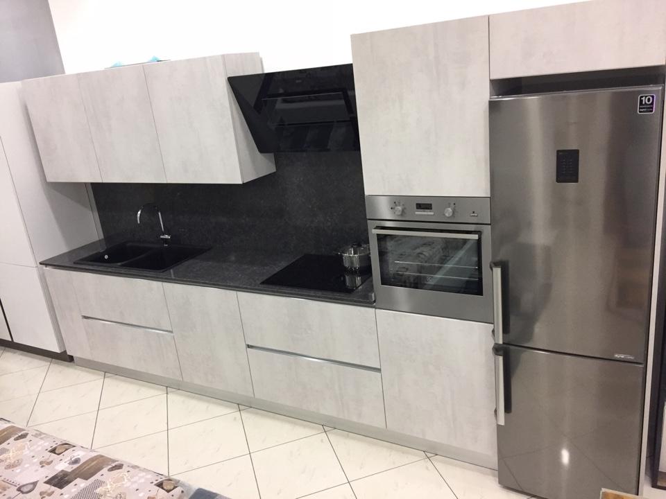 Cucina lineare astra cucine effetto cemento piano quarzo con elettrodomestici cucine a prezzi for Piano cucina in cemento