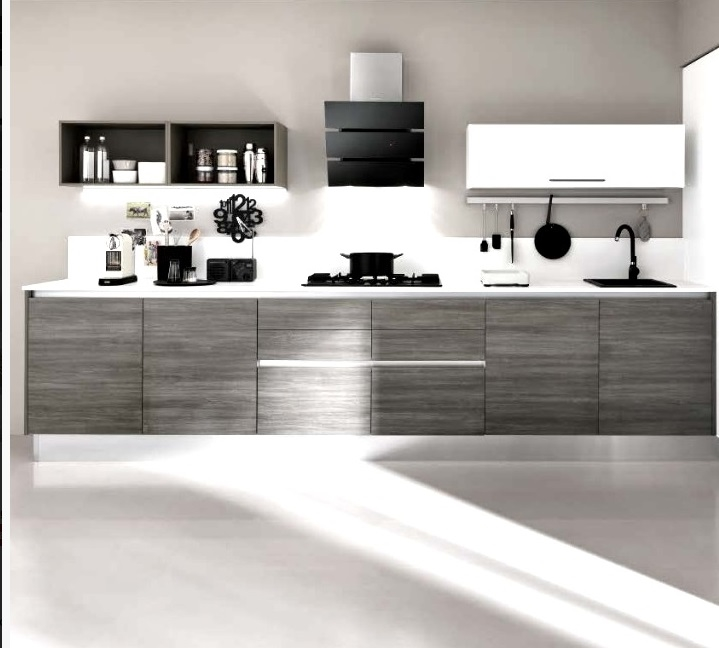 cucina moderna minimal essenza con gola in grigio e beige materico design industrial - Cucine a ...