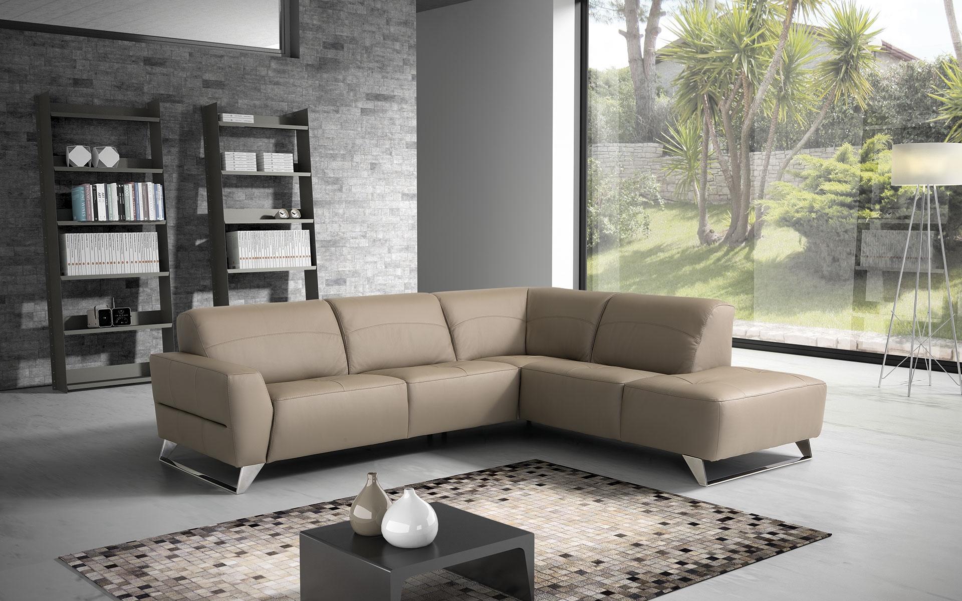Divano angolare in pelle moderno prezzo outlet divani a for Divano prezzo