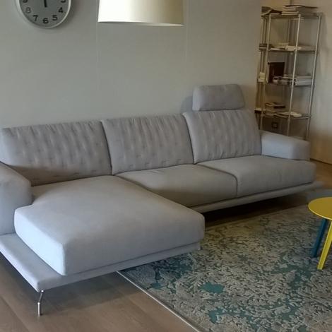 Divano in tessuto con chaise longue e poggiatesta scontato - Poggiatesta per divano ...