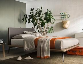 letto legno con testata rivestita cuoio