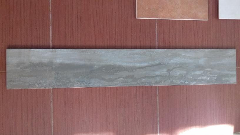 Pavimento piastrelle effetto legno in stock ufficio - Pavimenti piastrelle prezzi ...