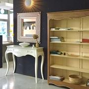 Libreria Le Fablier realizzata completamente in legno anticato con tarlo a vista e laccato stracciato interno color avorio