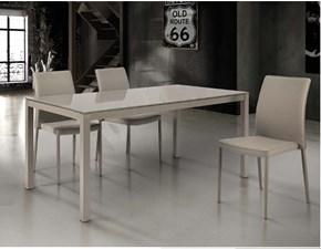 tavolo allungabile con piano in vetro e sedie in ecopelle