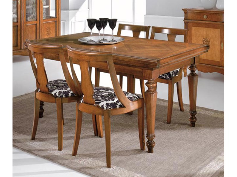 https://www.outletarredamento.it/img/tavoli/tavolo-in-legno-allungabile-intarsi-di-noce_N1_254845.jpg