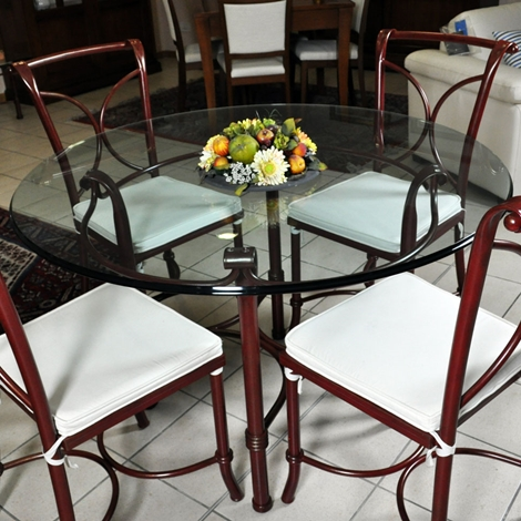 tavolo in vetro e 4 sedie in ferro battuto in saldo a